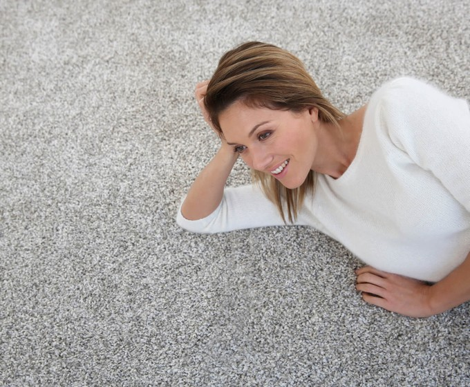 woman laying on carpet | Midway Carpet Distributors
