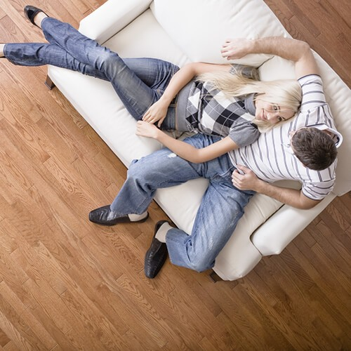 couple on hardwood   Midway Carpet Distributors