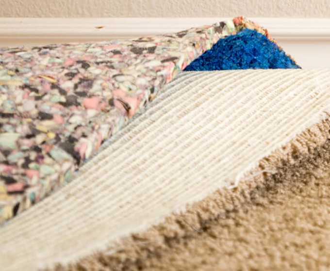 Tearing up carpet for installation | Midway Carpet Distributors